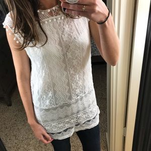 White lace and pompom tunic top